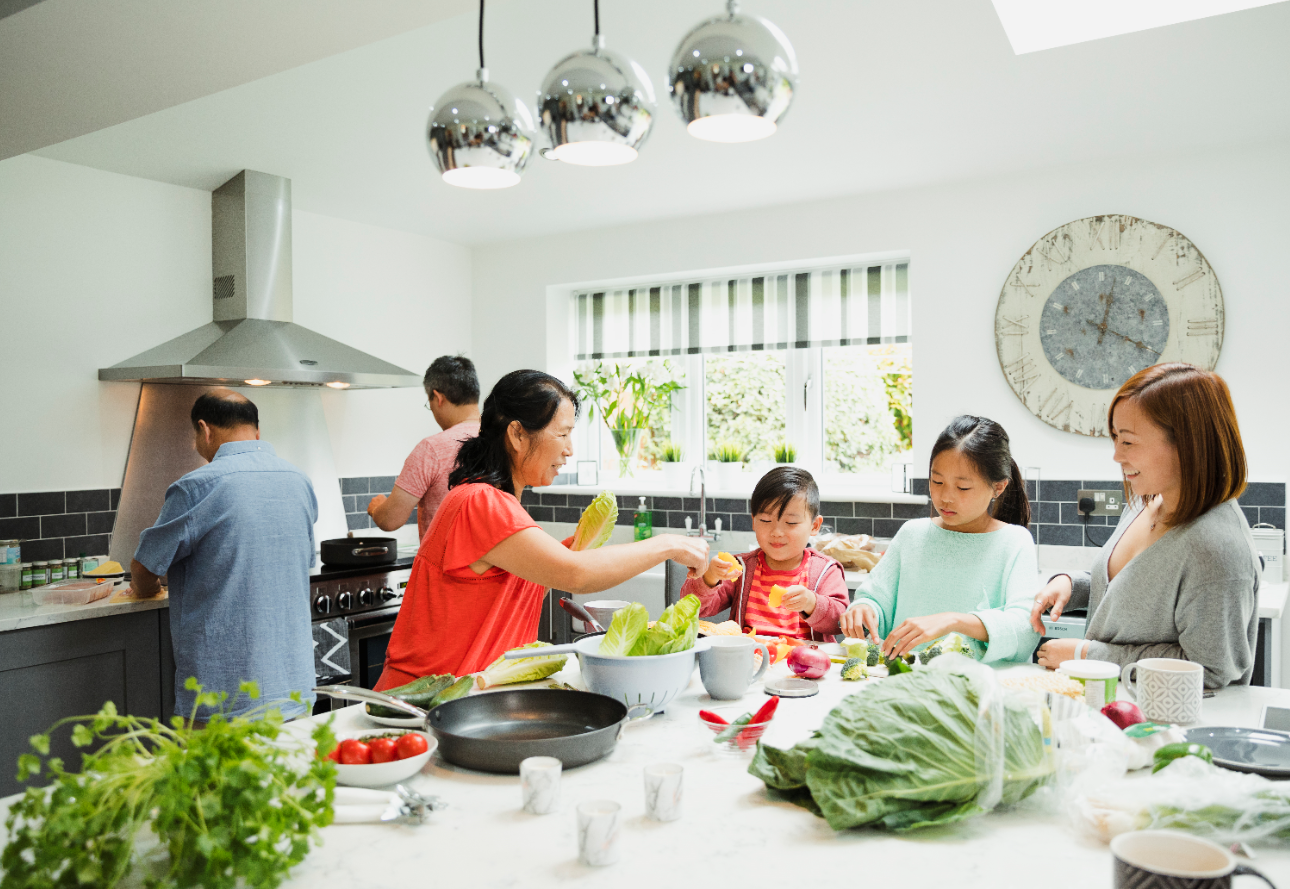A family cooking together for a Christmas feast with elderly loved ones